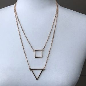 Geometric gold tone layered necklace.